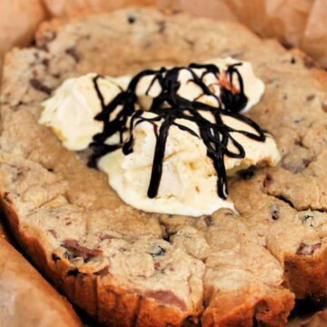 Slow cooker giant cookie with ice cream and chocolate sauce