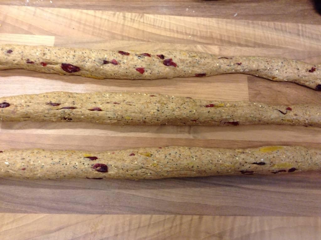Three long thin rolls of dough.