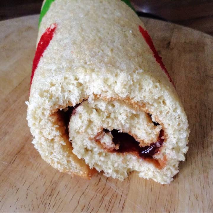 Close up of the jam filling in a patterned Swiss roll.