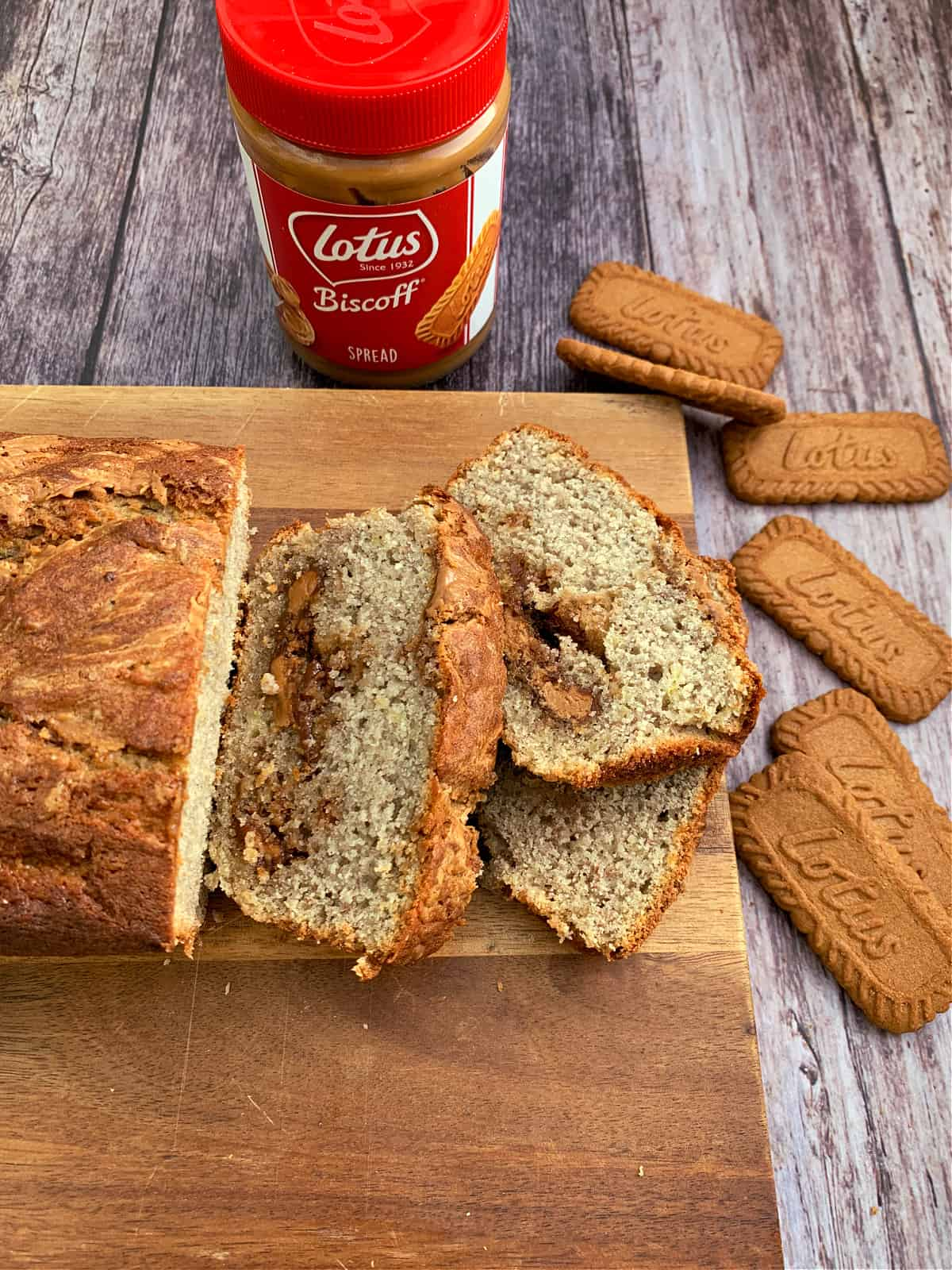 Banana bread with Biscoff spread inside and Biscoff spread and biscuits to the side.