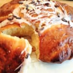 Tear and share brioche on cake stand with one brioche pulled apart.