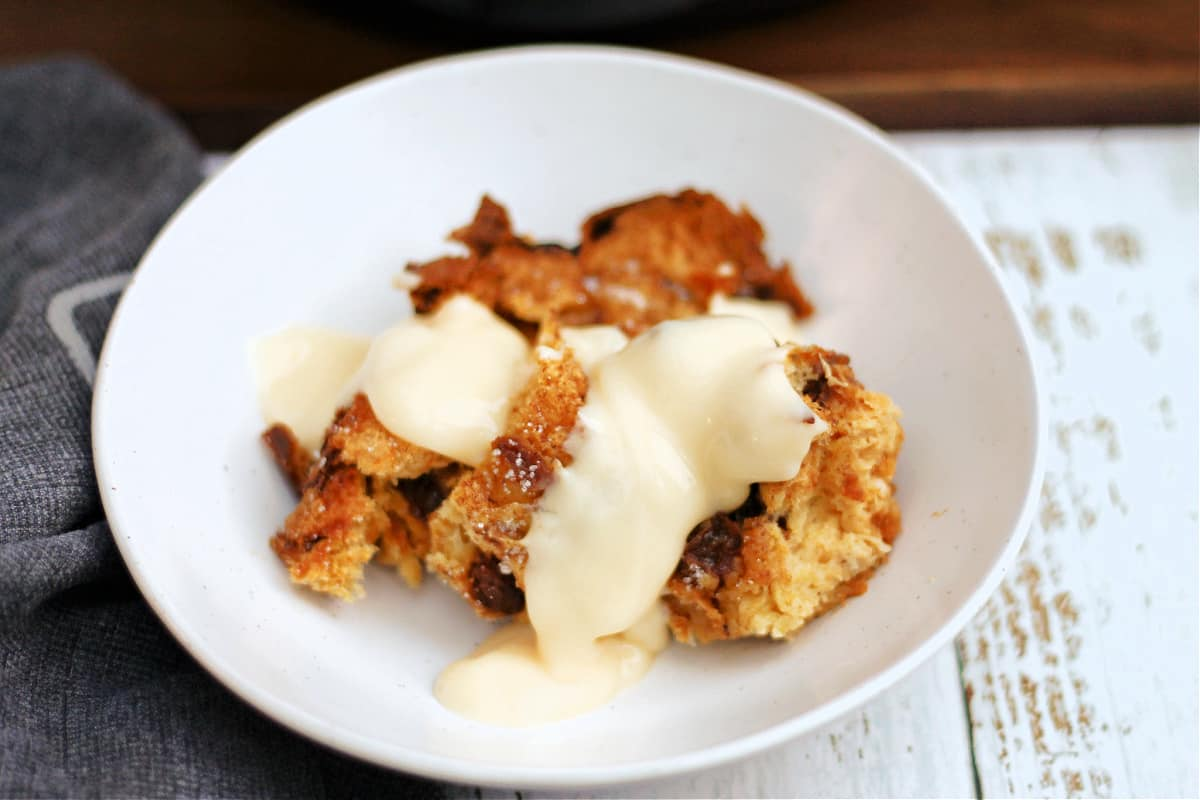 Bowl of panettone French toast with custard.