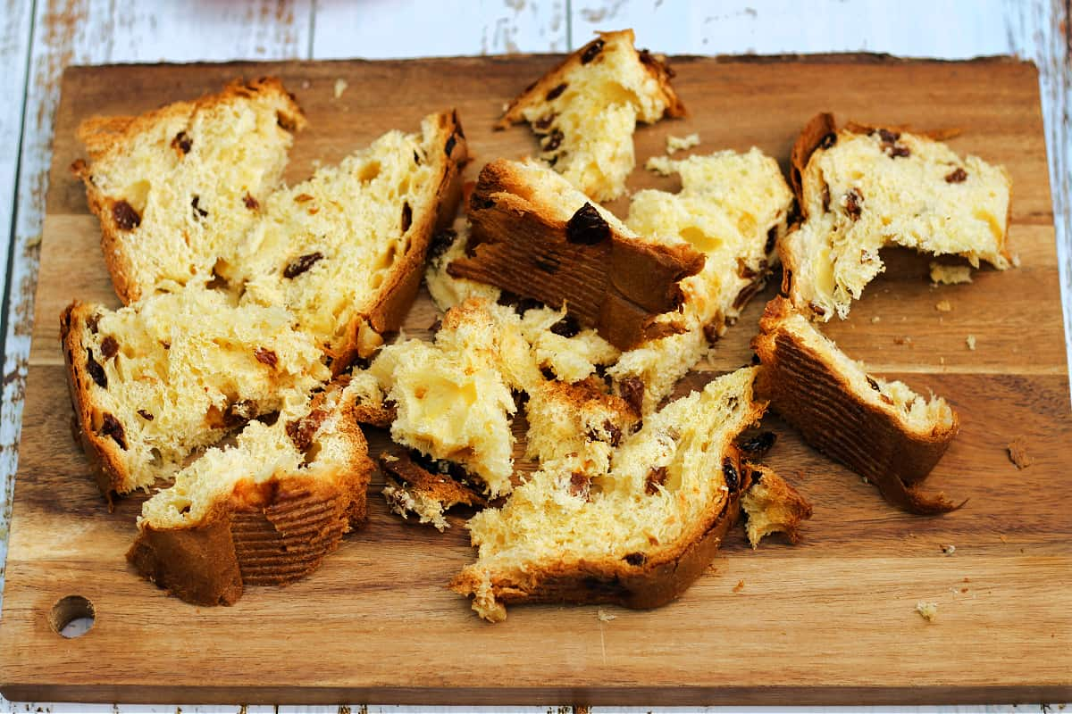 Sliced panettone on wooden board.