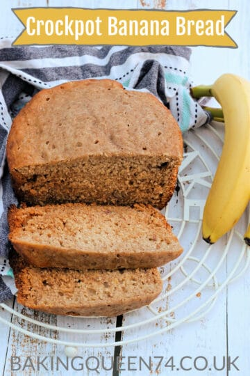 Sliced banana loaf on a rack, with a banana to the side, with text overlay (crockpot banana bread).
