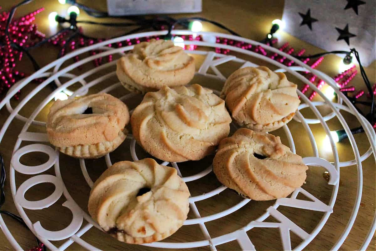 Mince pies on a cooling rack.