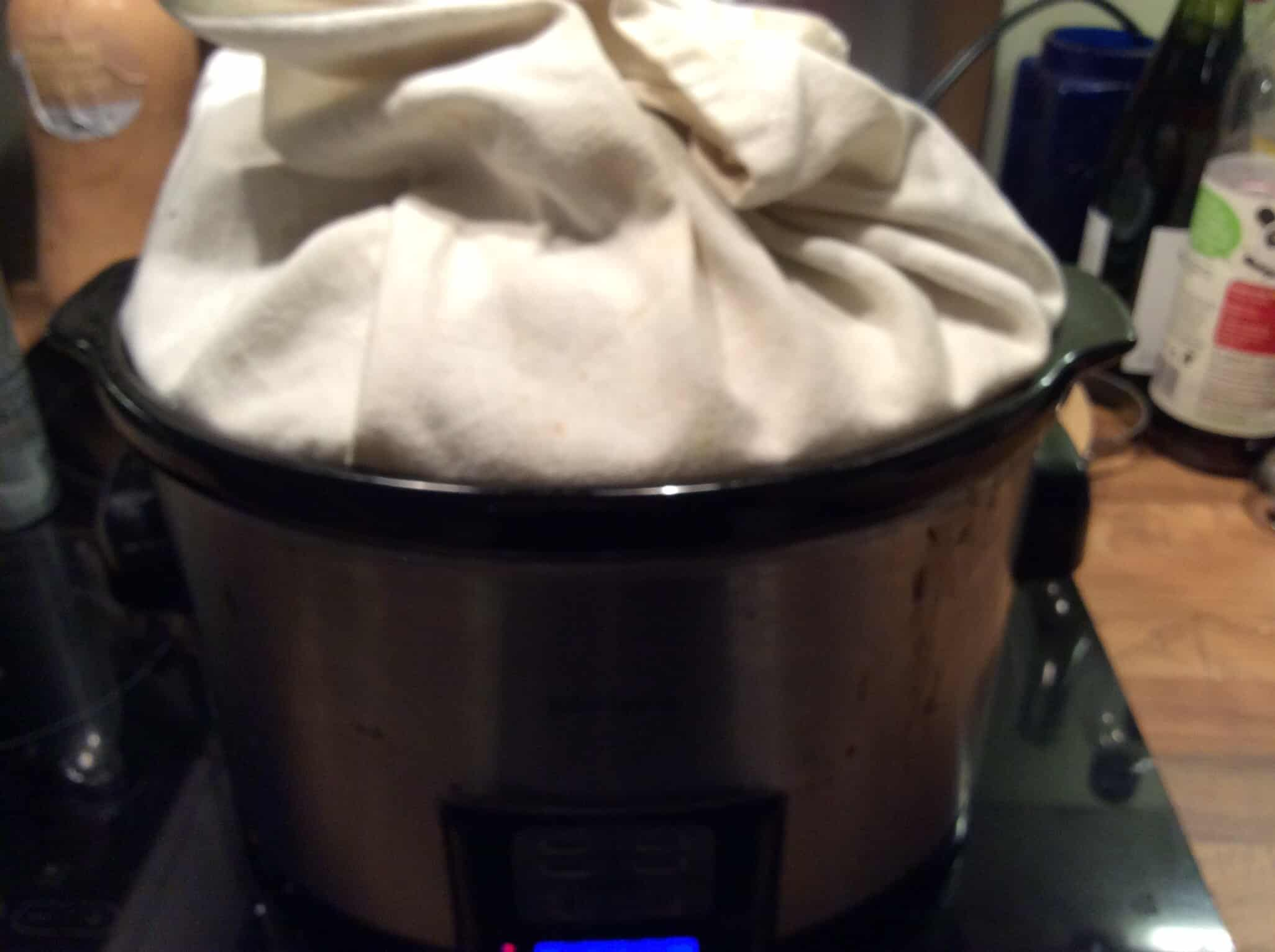 Make a cake in a slow cooker - tea towel under the lid with sides folded up