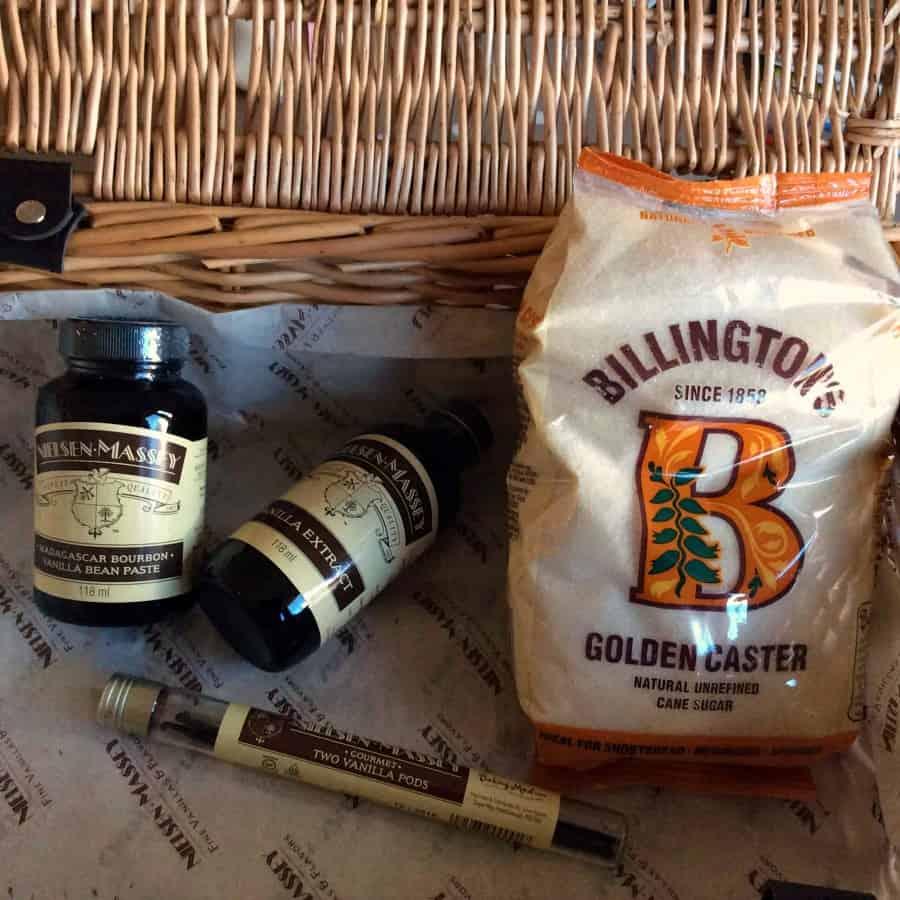 Hamper with vanilla extract, golden caster sugar and vanilla pods inside.