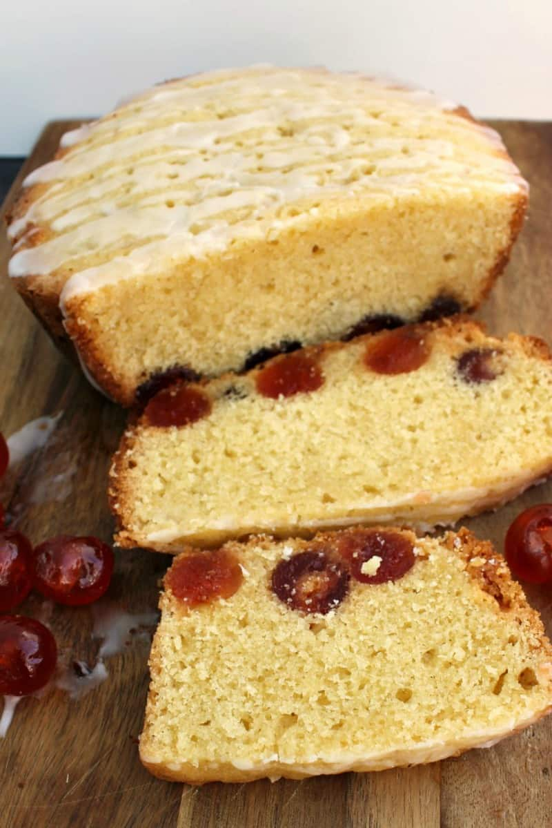 Cherry cake sliced on a chopping board.