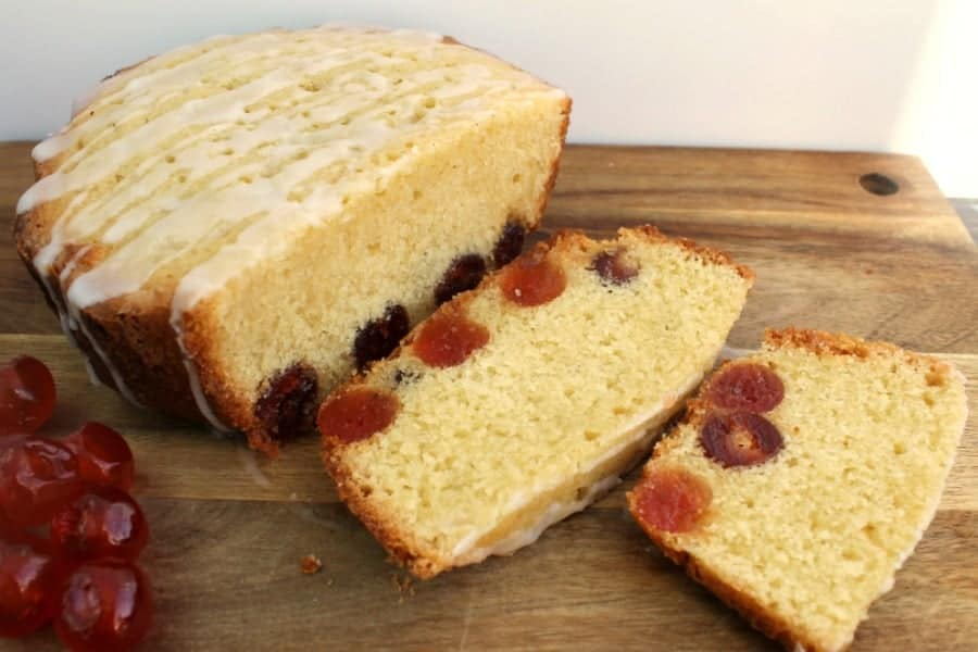 Sliced cherry cake on a chopping board.