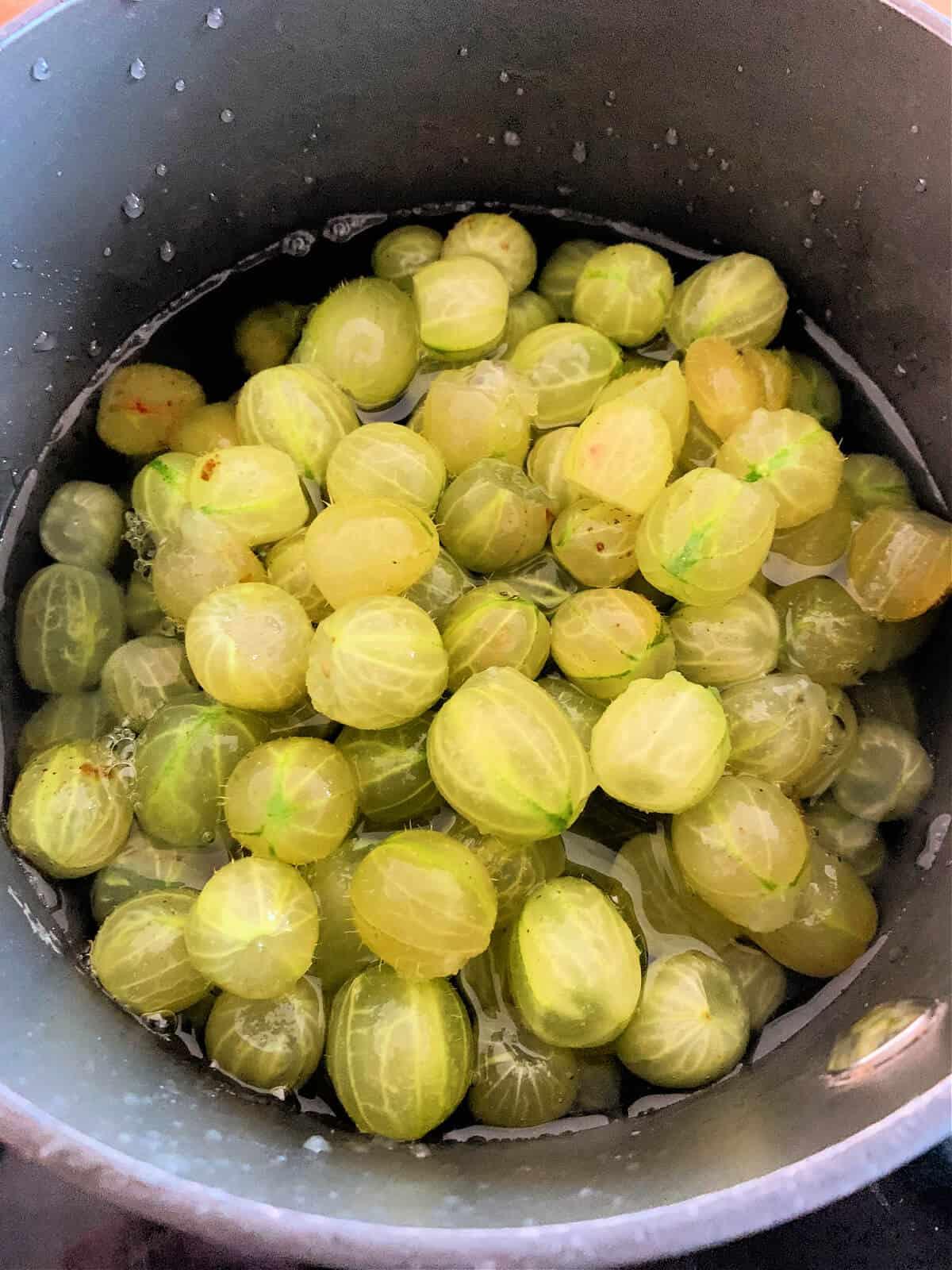Gooseberries in jam pan.