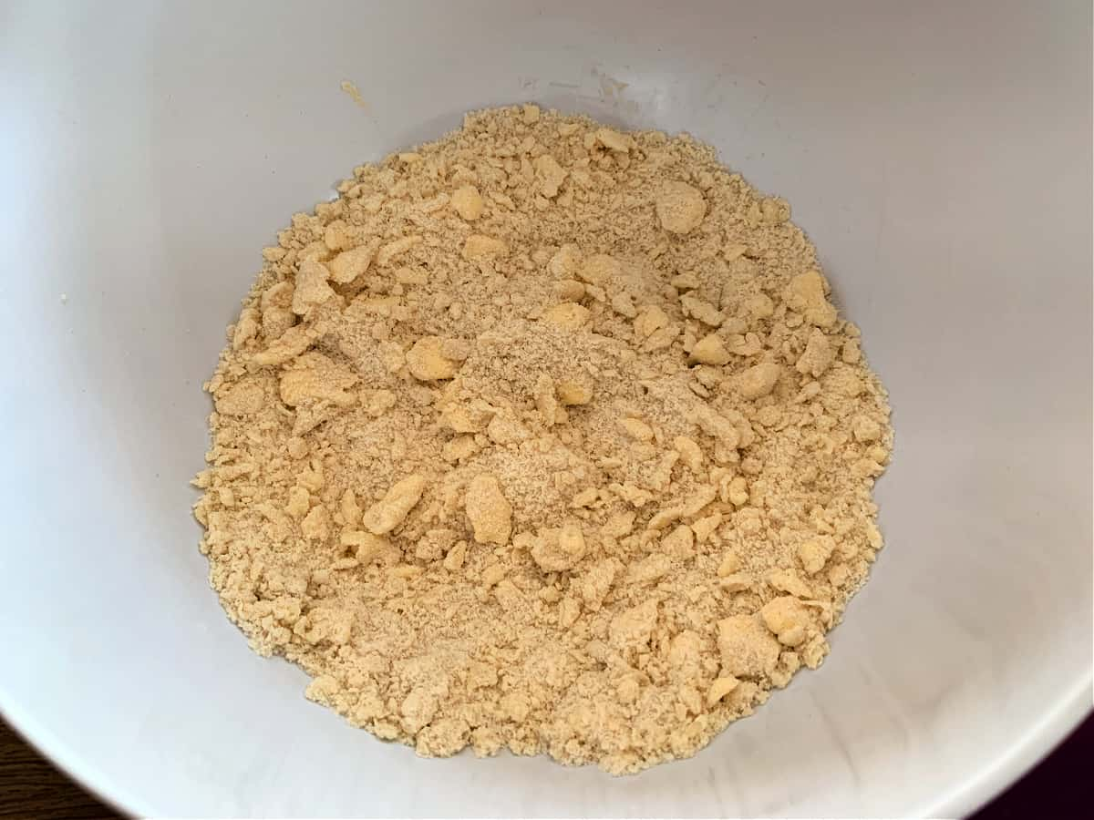 Crumble mixture (large breadcrumb texture) in a white bowl.