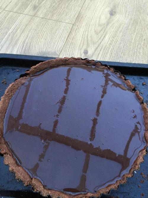 Mirror glaze poured onto the tart.