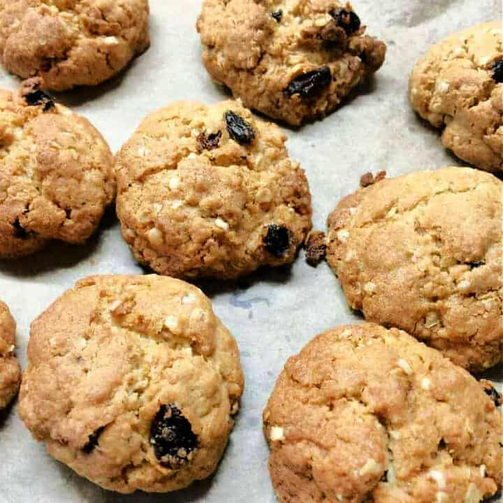 Close up of oat raisin cookies on a baking tray.