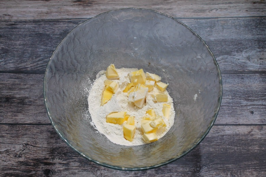 Flour with cubes of butter in a bowl