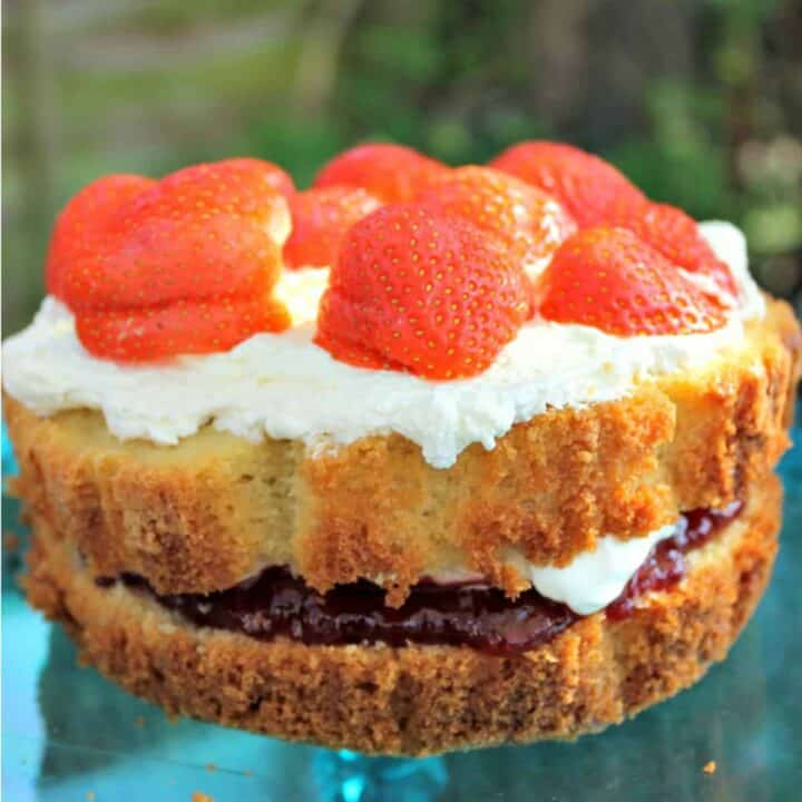 Close up of cake with strawberries on top.