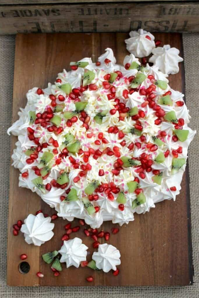 Pomegranate and kiwi crown pavlova