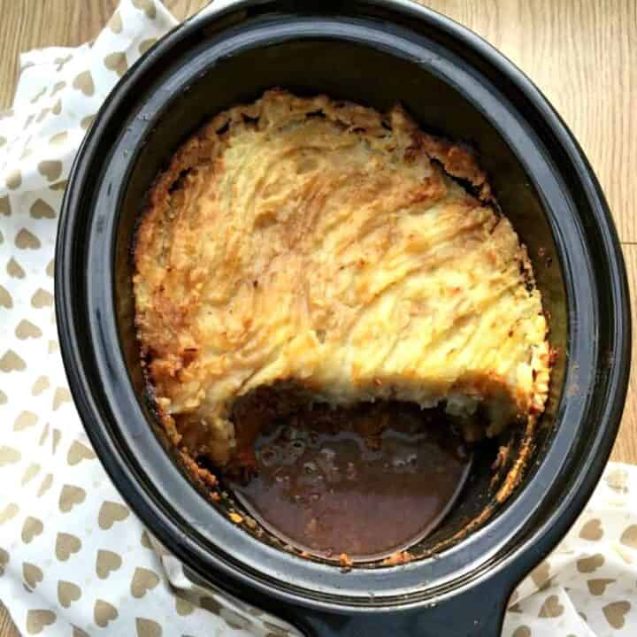 Cottage pie with mash in slow cooker pot.