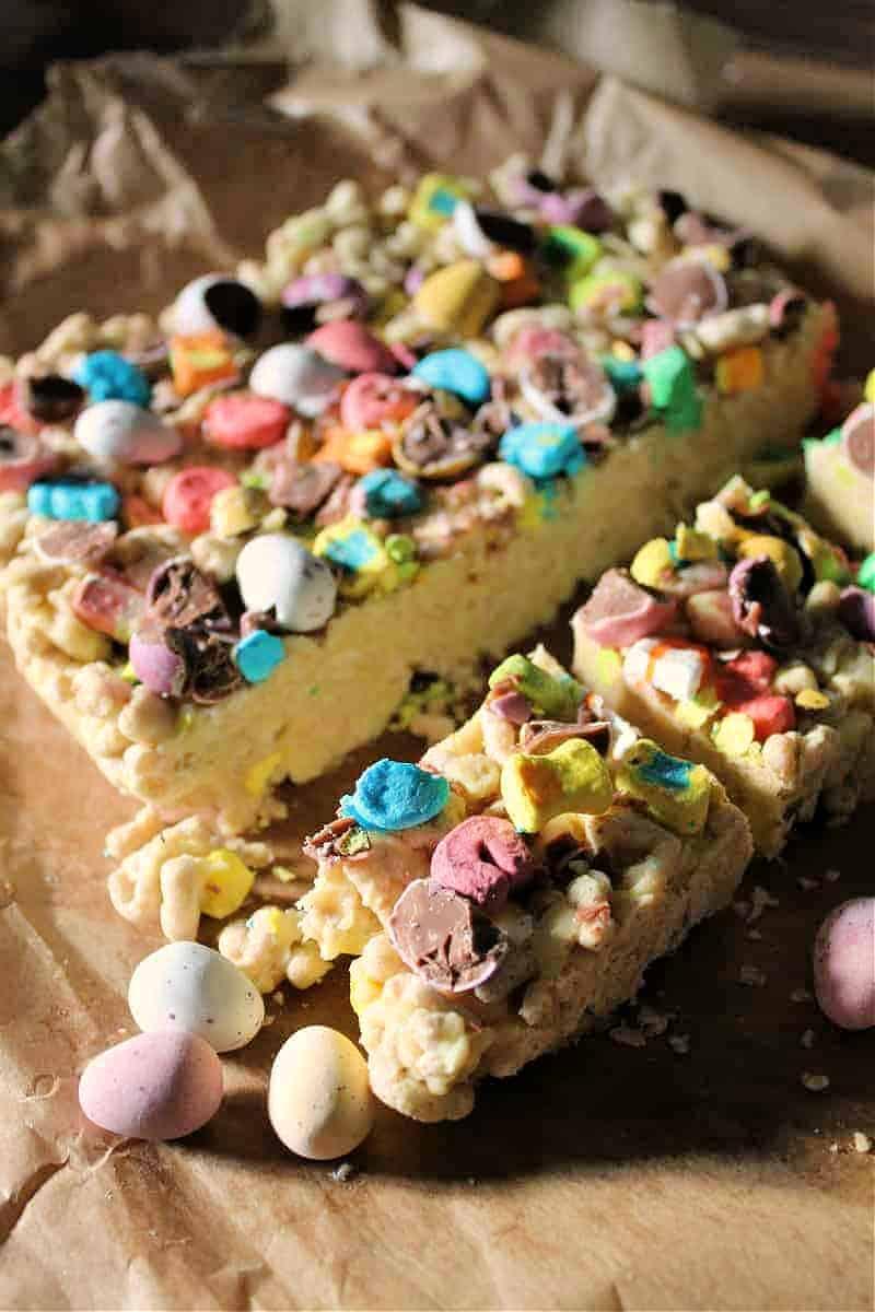 Close up of chocolate slice with colourful chocolate toppings.