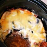 Close-up of moussaka in serving dish, being served,
