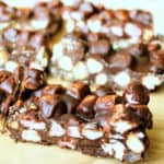 Slices of rocky road, showing the marshmallows and biscuit inside.