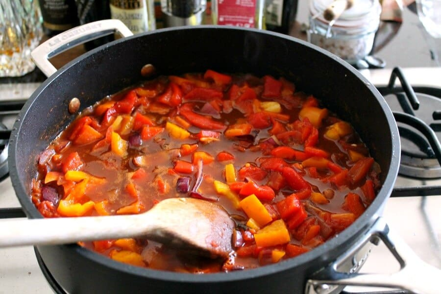 Making the goulash sauce in a frying pan for paprika pork goulash