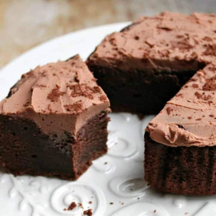 Close up of chocolate cake on a white plate.