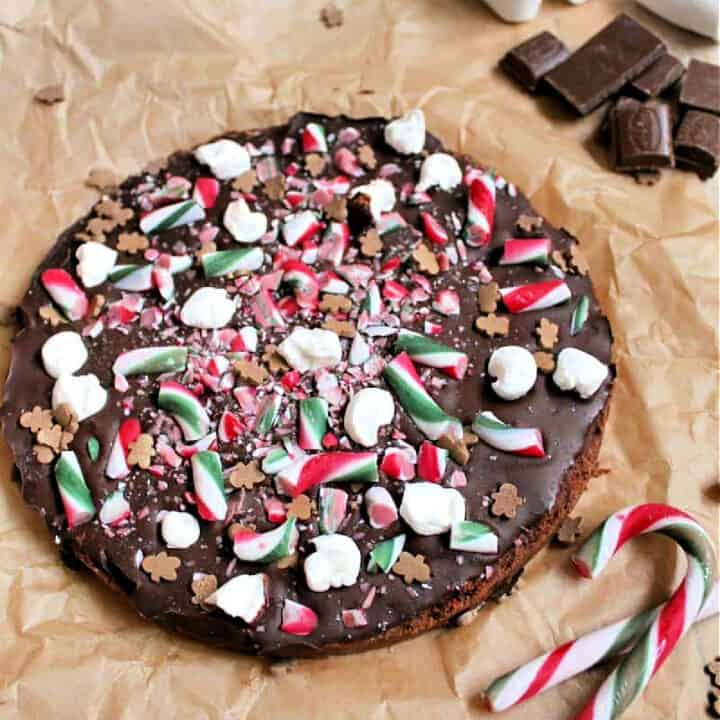 Chocolate shortbread covered with chocolate and decorated with Christmas treats.
