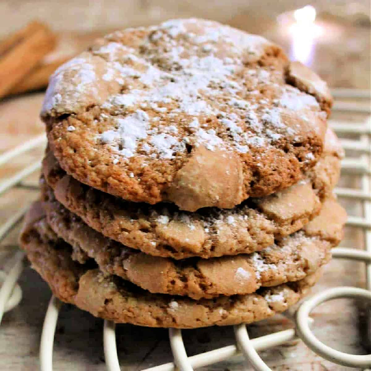 A stack of cookies with powdered sugar dusted on top.