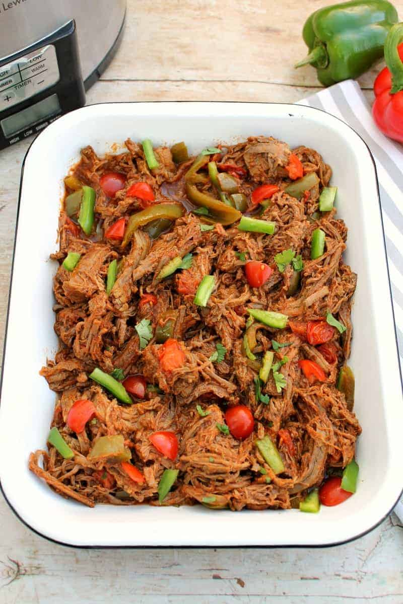 Pulled beef in a white serving dish.