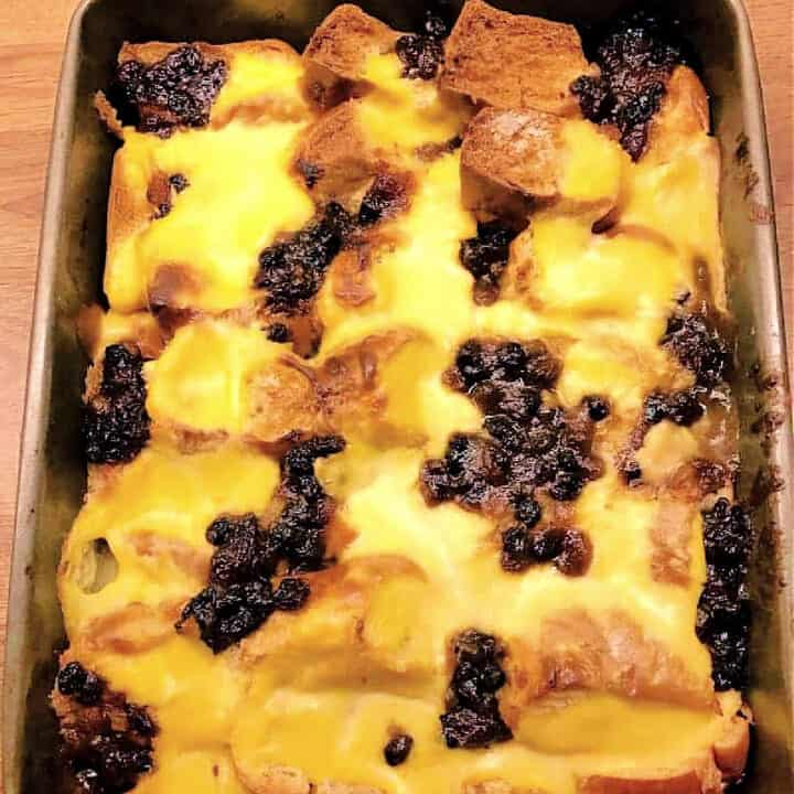 Close up of bread and butter pudding made with custard and mincemeat.