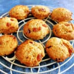 Scones on a white round rack on a blue background.