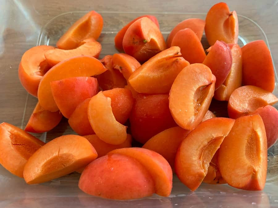 A tub of chopped fresh apricots.