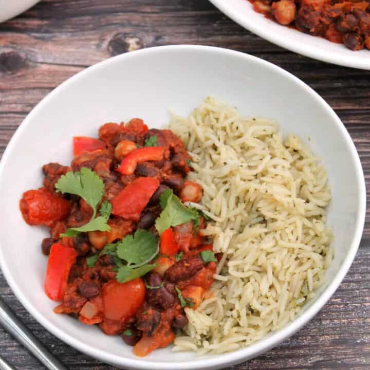 White bowl of bean chilli and rice.