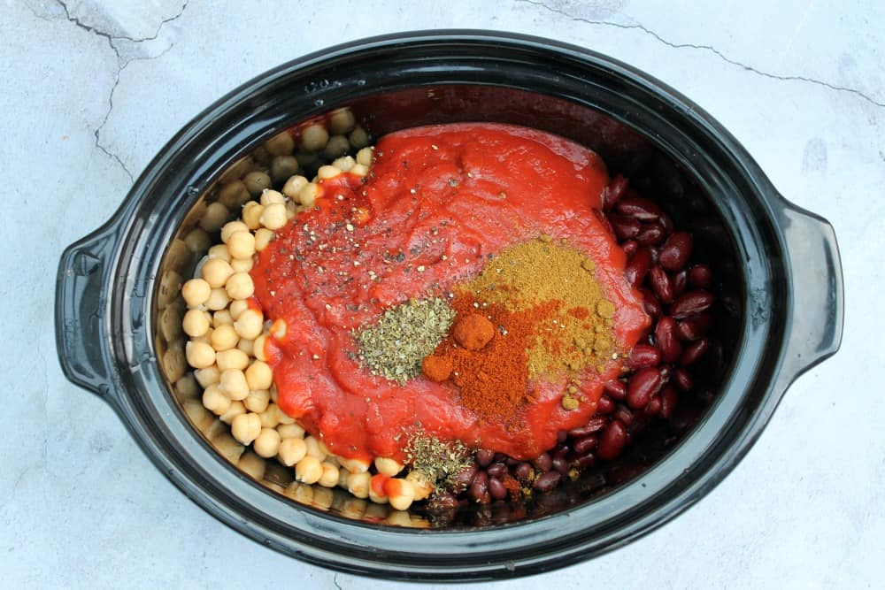 Ingredients and spices in slow cooker pot.