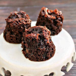 Slow cooker muffins on a small white cake stand.