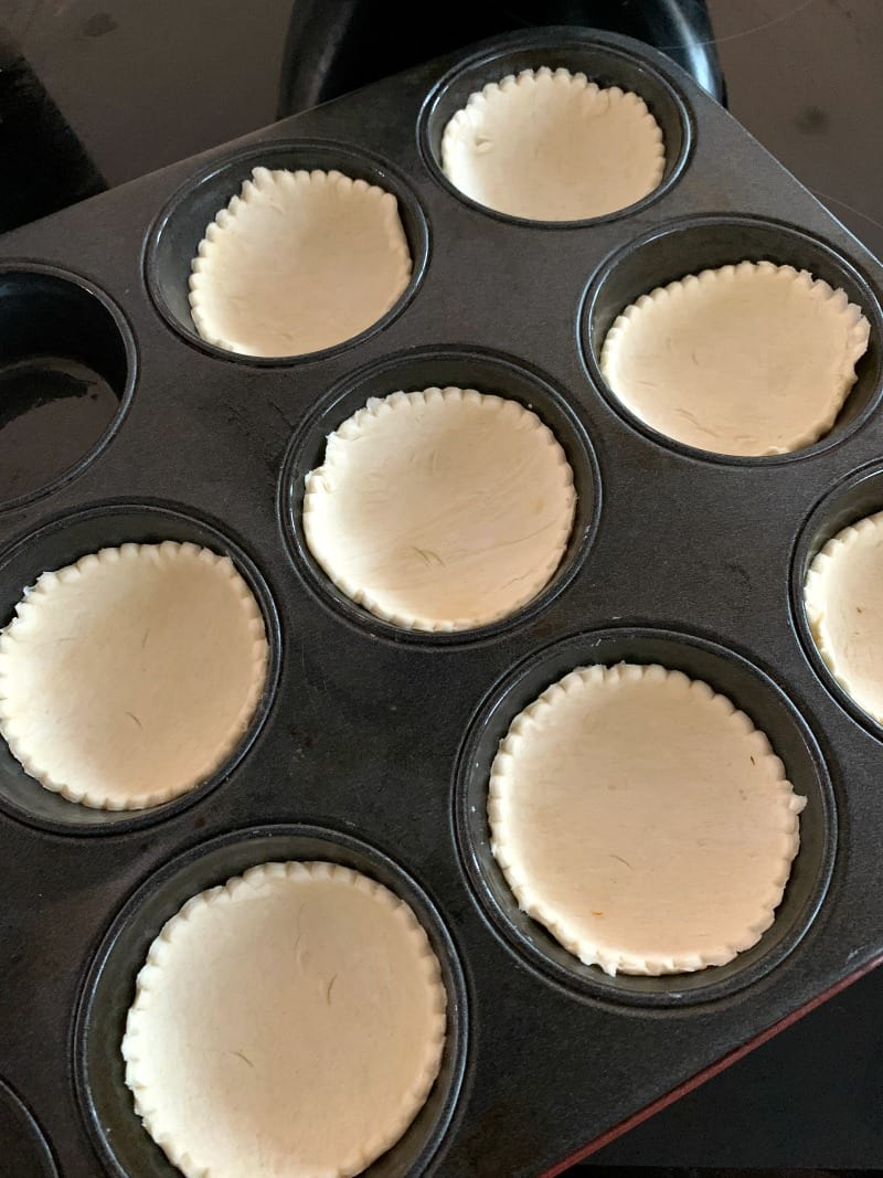 Mince pies pastry bases in a tin.