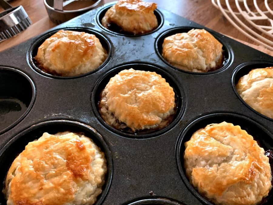 Cooked mince pies in tin after baking.