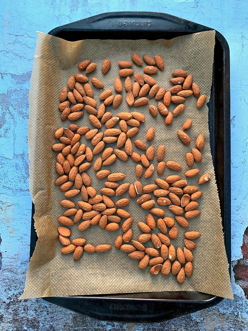 Almonds on a baking tray.