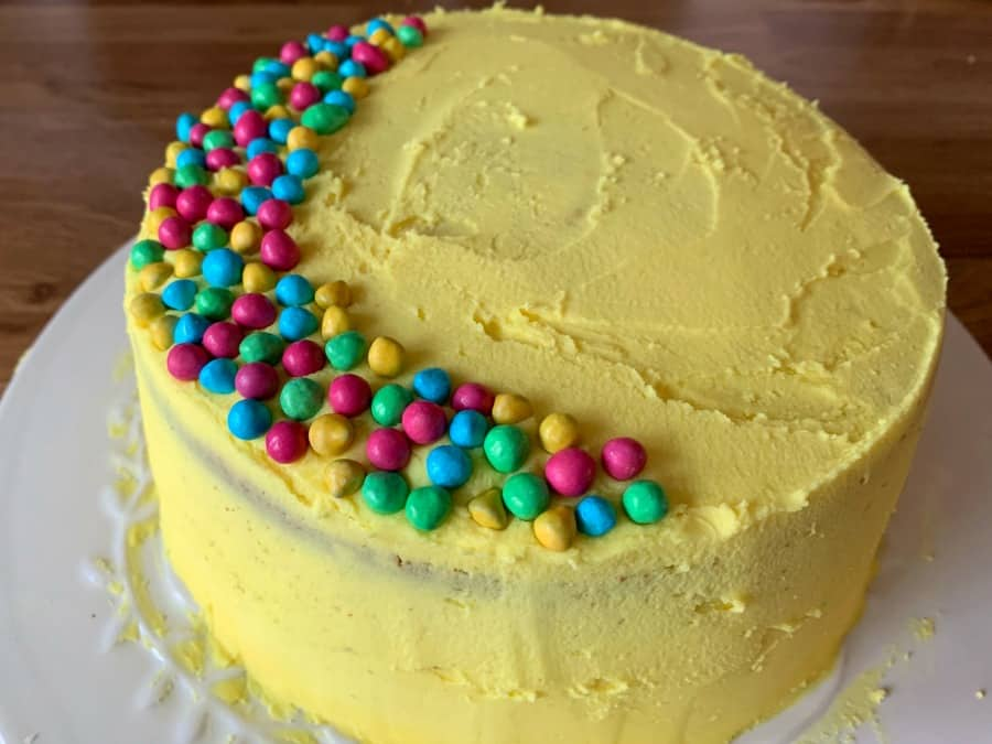 Finished cake with smooth buttercream and sprinkles.
