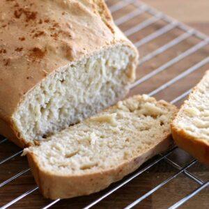 Bread loaf on a cooling rack.