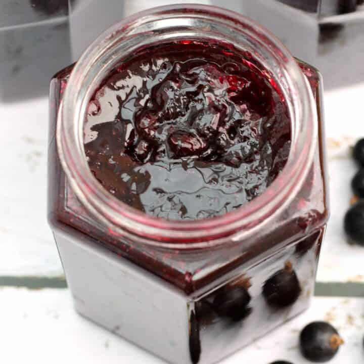 Close up of blackcurrant jam in the jar, from above.