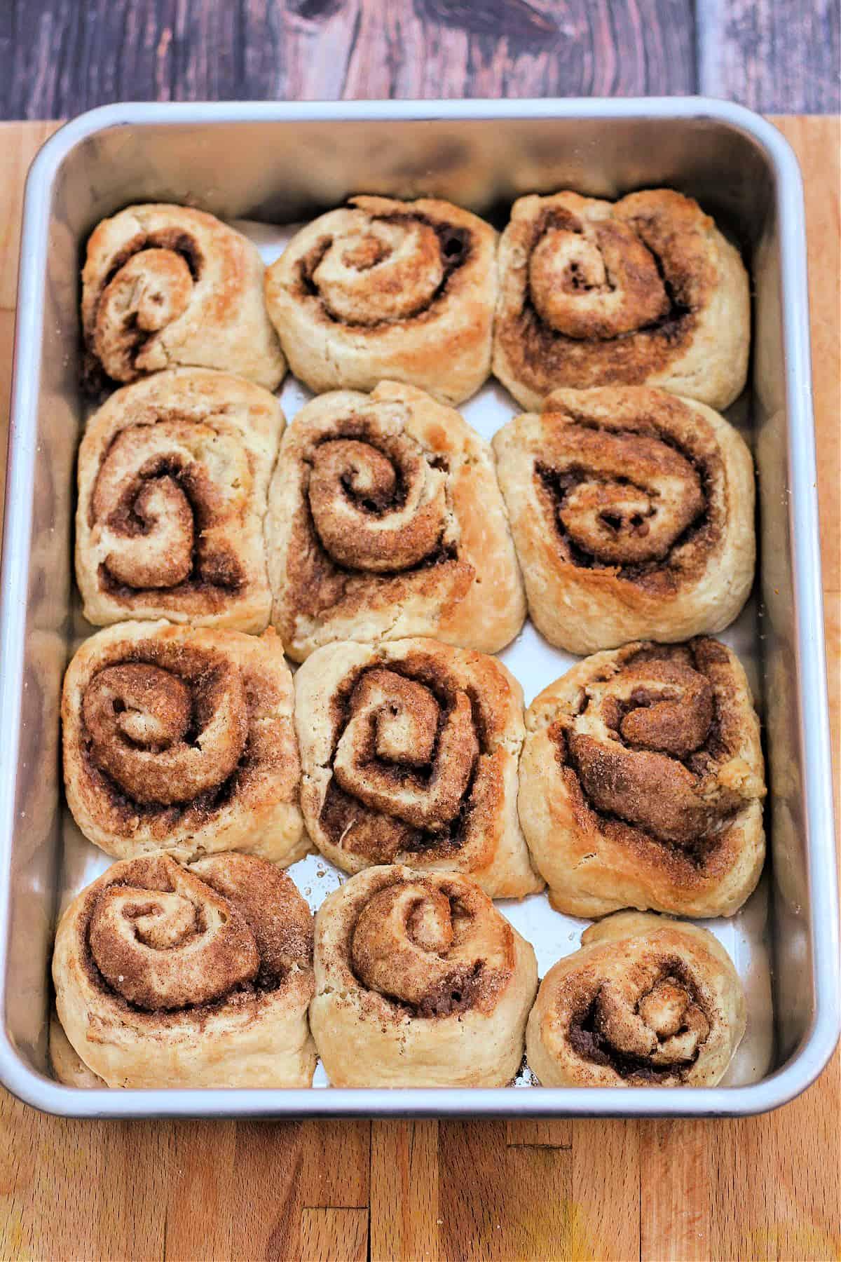 Baked cinnamon swirls in baking tin.