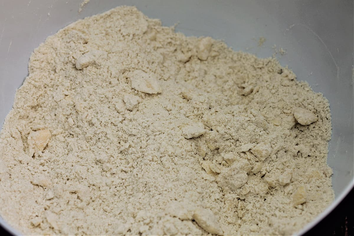 Flour with butter rubbed in to coarse breadcrumb stage in a bowl.