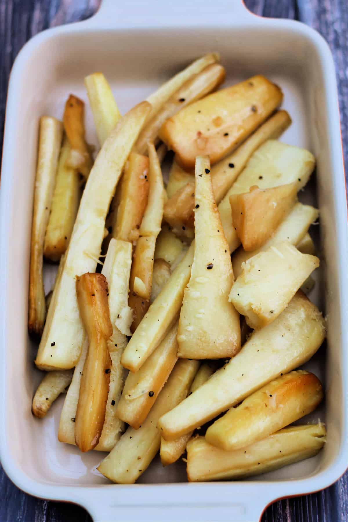 Roast parsnips in dish.