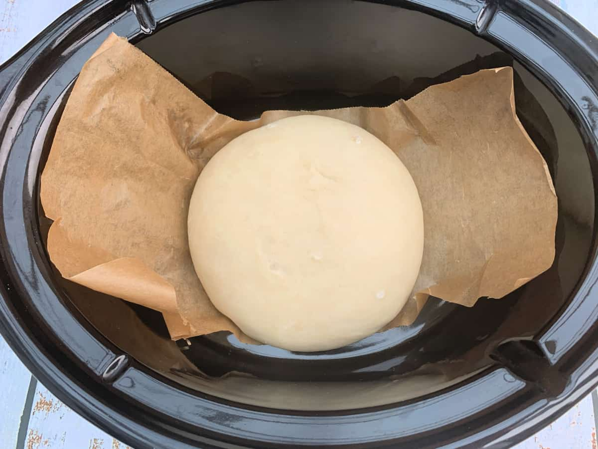 Ball of dough in slow cooker, doubled in size from previous image.