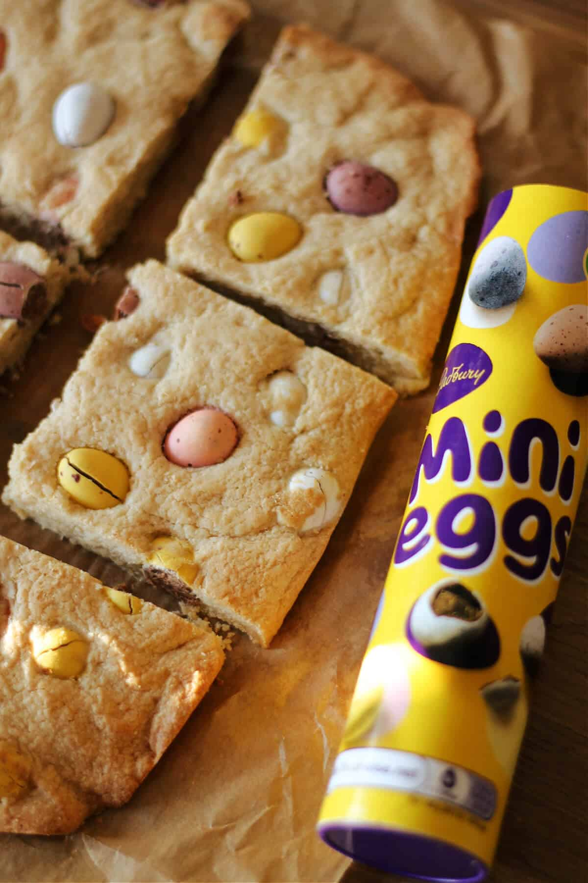 Tube of mini eggs next to cookie bars.