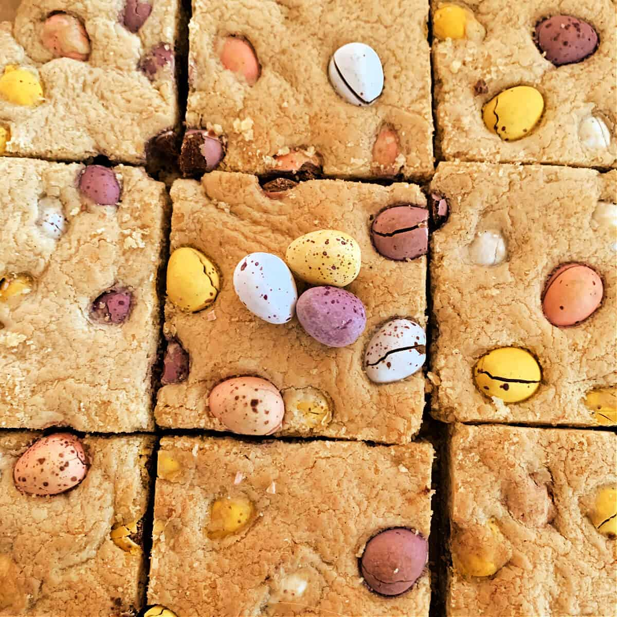 Cookie bar squares with Cadbury Mini Eggs on top;