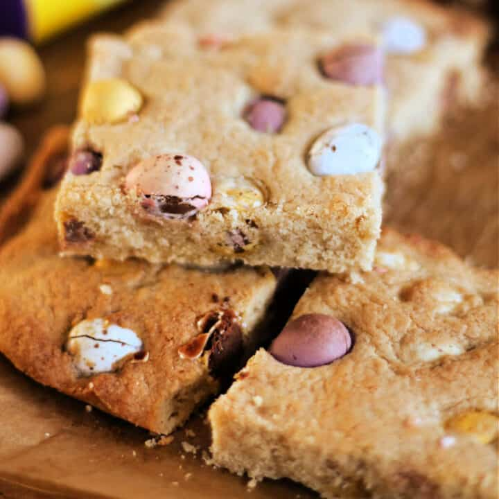 Stack of square cookie slices with Cadbury Mini Eggs.