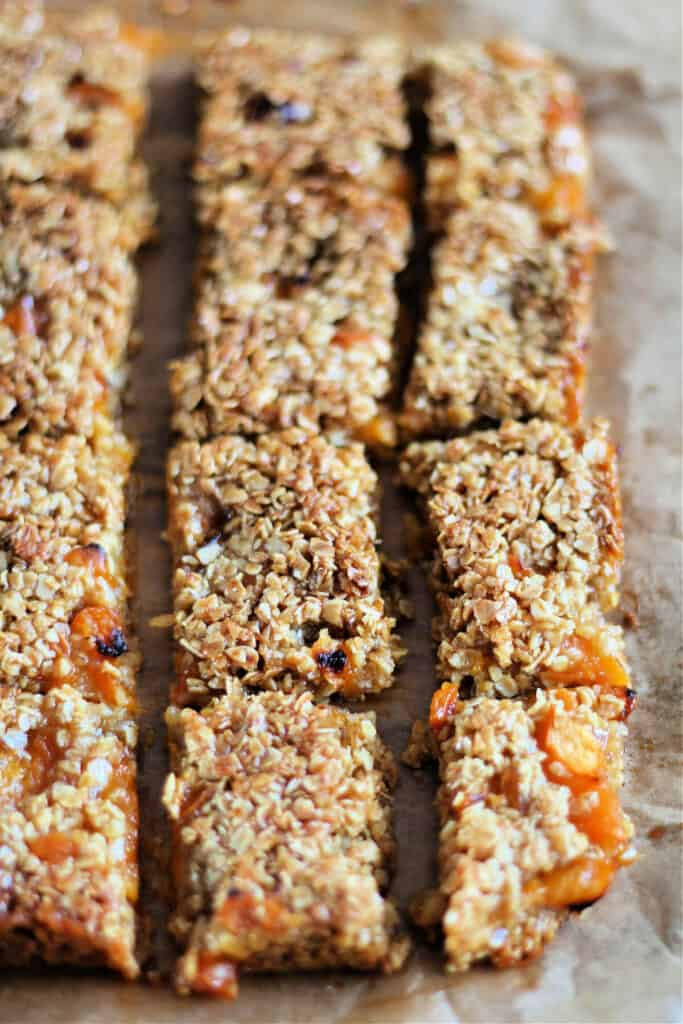 Flapjack slab with apricots scored into pieces.
