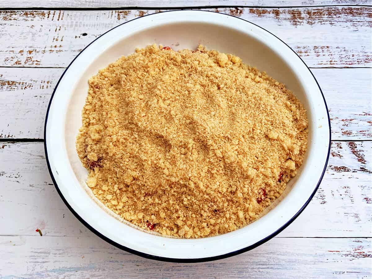 Crumble ready to bake in round pie dish.